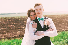 Lovely bride and groom on the field Royalty Free Stock Photo