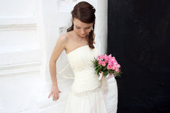 A lovely bride looks down Royalty Free Stock Photos