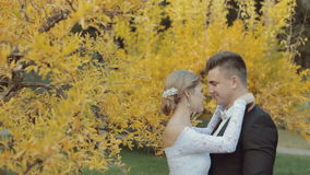 Lovely bride passionately kisses her young stock footage