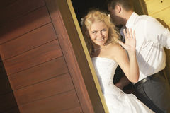Lovely bride saying good bye near door after wedding. Royalty Free Stock Photos