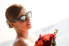 Lovely bride smile in the city sunny day water sea flower bouquet Stock Images