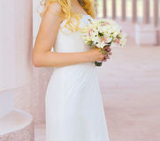 Lovely bride and wedding bouquet Stock Image