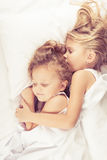 Lovely brother and sister lying in bed at home Royalty Free Stock Photography