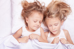 Lovely brother and sister lying in bed at home. Concept of Brother And Sister Together Forever Stock Image