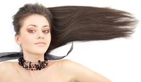 Lovely brunette in black collar. Portrait of lovely brunette in black collar stock photo