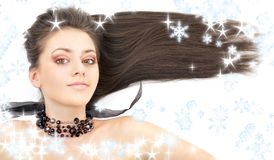 Lovely brunette in black collar with snowflakes Stock Photos