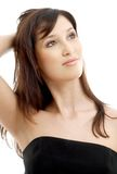 Lovely brunette in black dress Stock Photography