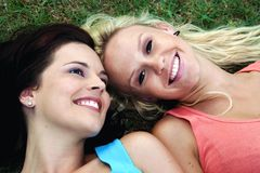 Lovely Brunette and Blonde Friends Stock Images
