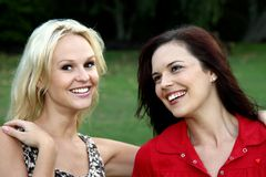 Lovely Brunette and Blonde Friends Royalty Free Stock Image