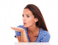 Lovely brunette in blue t-shirt blowing a kiss Royalty Free Stock Images