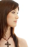 Lovely brunette with cross Royalty Free Stock Image