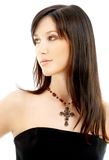 Lovely brunette with crucifix Stock Images