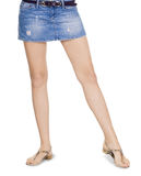 Lovely brunette in denim skirt Royalty Free Stock Photo