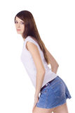 Lovely brunette in denim skirt Stock Images