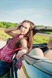 Lovely brunette female near car Stock Photography