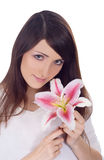 Lovely brunette with flower in hands Stock Photos