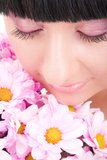 Lovely brunette with flowers Royalty Free Stock Images