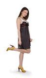 Lovely brunette girl in brown dress Stock Images