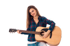 Lovely brunette girl playing guitar Royalty Free Stock Photos