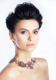 Lovely brunette hairstyle model with necklace Stock Images