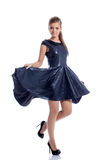 Lovely brunette posing in trendy dark blue dress Royalty Free Stock Photography