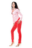Lovely brunette in red jeans Stock Images