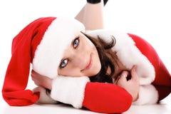 Lovely brunette in Santa costume lays on floor. Stock Image