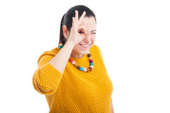 Lovely brunette showing ok sign Royalty Free Stock Photography