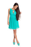 Lovely brunette in a turquoise dress Stock Image