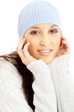 Lovely brunette in winter hat. Portrait of lovely brunette in winter hat Stock Photos