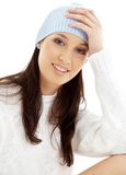 Lovely brunette in winter hat #2. Portrait of lovely brunette in winter hat Stock Images