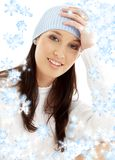 Lovely brunette in winter hat with snowflakes #2. Portrait of lovely brunette in winter hat with snowflakes Stock Photos