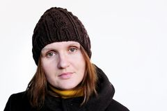 Lovely brunette woman in brown knitted hat Royalty Free Stock Photography