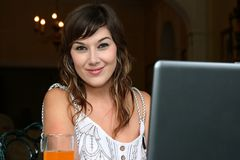 Lovely Brunette  Woman at Computer Royalty Free Stock Image