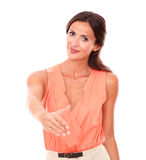 Lovely brunette woman giving her hand in greeting Royalty Free Stock Photo