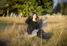 Lovely brunette woman seated in the sunlight Stock Images