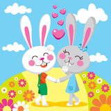 Lovely Bunny Date. Sweet bunny couple holding hands on a date smiling and walking between flowers Stock Image