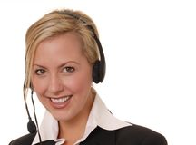 Lovely Business Lady 12. Beautiful and sexy blond business woman with headset Stock Photo