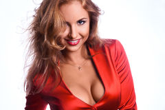 Lovely business woman in red jacket smiling on camera Stock Images