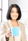 Lovely businesswoman with mug Royalty Free Stock Images