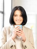 Lovely businesswoman with mug Royalty Free Stock Image