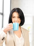 Lovely businesswoman with mug Stock Image