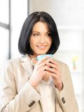 Lovely businesswoman with mug Royalty Free Stock Photography