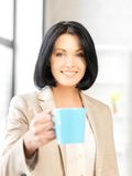 Lovely businesswoman with mug Stock Photography