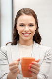 Lovely businesswoman with mug Stock Images