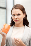 Lovely businesswoman with mug Stock Photo