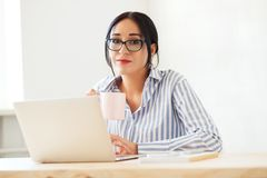 Lovely businesswoman at work royalty free stock image