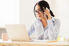 Lovely businesswoman at work stock image