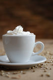 Lovely cappuchino. Coffe and corn on the table Royalty Free Stock Images