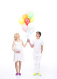 A lovely Caucasian couple holding balloons Royalty Free Stock Photo